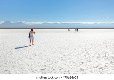 Tourists in saline lagoon near San Pedro de Atacama - Chile, South America.
