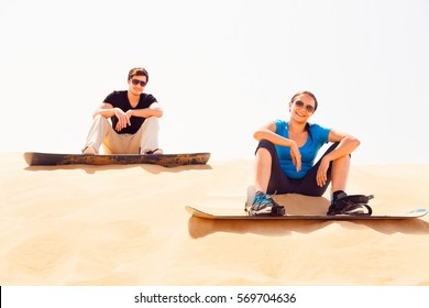 Tourists Sand Skiing In The Desert
