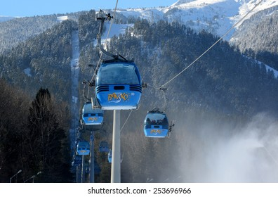 Tourists skiing Ski resort Bansko, Bulgaria Feb 11, 2015. Panorama of winter mountains.View of cabins in fir forest, Bansko, Bulgaria