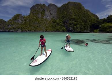 Tourists Stand up paddling in Wayag Island Raja Ampat Indonesia January 2016