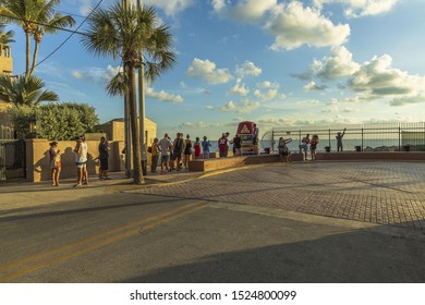 Tourists standing in line in order to take picture at famous tourist attraction Southernmost point. Key West. Florida. USA. 09.06.2019