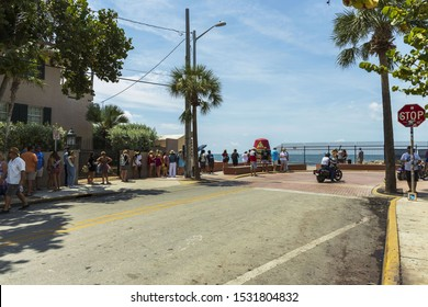 Tourists standing in line in order to take picture at famous tourist attraction Southernmost point. Key West. Florida. USA. 09.07.2019