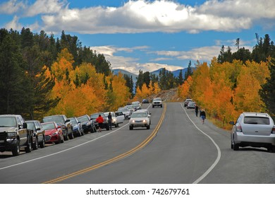 Tourists stop their cars along Colorado's Peak to Peak Highway, a Scenic Byway, to take in the Fall Colors