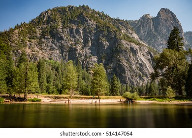 Tourists in the stream and beach, Yosemite National Park