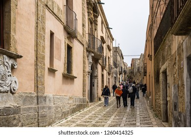Tourists strolling in the main street of Erice, an historic town near Trapani. Erice, Sicily, Trapani province, Italy, April 2018