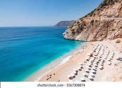 Tourists sunbathing and swimming on the Kaputas Beach, Kas, Antalya Turkey