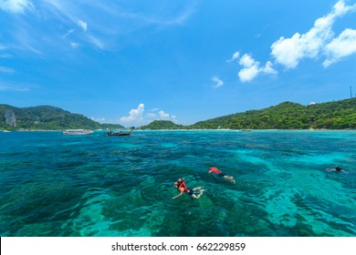 Tourists swimming and snorkeling in Andaman sea at Phi Phi islands one of the most beautifull island in Thailand