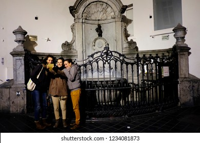 Tourists take photos in front of the famous Belgium's Manneken Pis sculpture  in Brussels, Belgium on Nov. 17, 2018