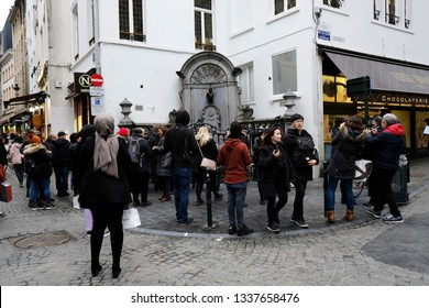 Tourists take photos in front of the famous Belgium's Manneken Pis sculpture  in Brussels, Belgium on March 3, 2019