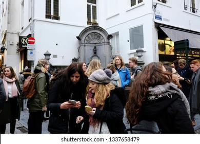 Tourists take photos in front of the famous Belgium's Manneken Pis sculpture  in Brussels, Belgium on March 1, 2019