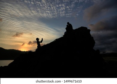 Tourists take pictures at Mandalika Kuta Beach, Lombok, West Nusa Tenggara, Indonesia, on September 7, 2019