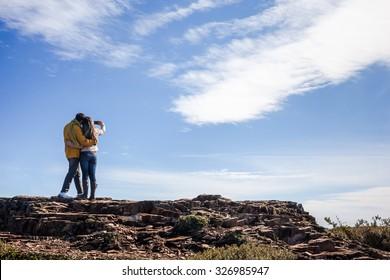 "Tourists taking a self portrait on the top of the ""Morro da Igreja"" - Urubici - SC - Brazil"