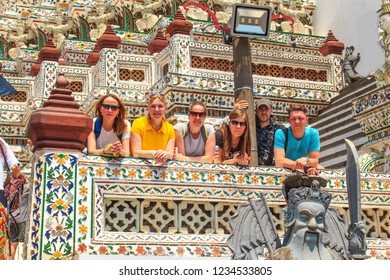 Tourists in the temple of Wat Arun (Temple of the Morning Dawn), Bangkok, Thailand.