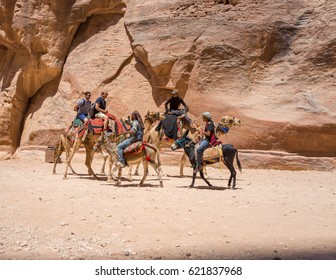 Tourists travellers visiting Petra in Jordan during summer vacation. Petra, Jordan - August 9, 2016