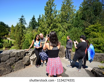 TOURISTS IN VANCOUVER - JULY 13, 2018: Vancouver's popular tourist place is also 13-acre  Queen Elizabeth Garden, located on the most higher Vancouver's spot at Little Mountains. B.C., Canada.