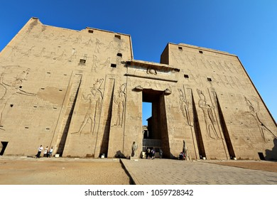 Tourists visit the ancient Egyptian ruins of the Temple of Horus at Edfu, Egypt.