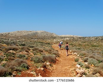 Tourists visit Balos in Crete, Greece and hiking toward to the beach. The Gramvousa Peninsula forms the westernmost of the two pairs of peninsula in Crete and the western part of Kissamos Bay.