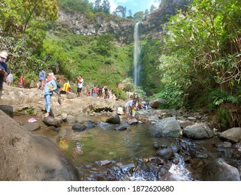 Tourists visit Coban Rondo waterfall during the new normal covid-19 in Batu City, East Java, Indonesia on August 12, 2020