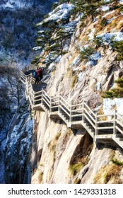 Tourists visit the famous Huangshan mountain. Mountain Huangshan is World cultural and natural heritage. It is one of the chief tourist attractions in China.