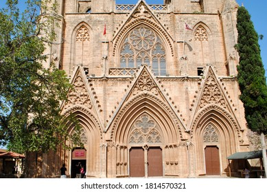 Tourists visit Lala Mustafa Pasha Mosque or Saint Nicholas Cathedral dated back 13th century in Rayonnant Gothic style. Famagusta , Magusa, Northern Cyprus