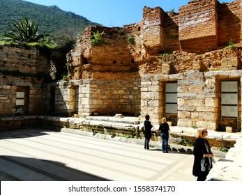 Tourists visit ruins of library in ancient Ephesus city in Selcuk. Efes is an UNESCO World Heritage Site and tourism attraction in Turkey. 2010-3