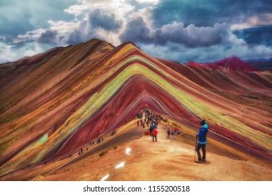Tourists visit Vinicunca, Montaña siete colores, January 2018, Cusco Peru.