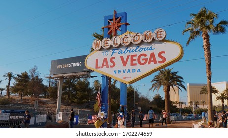 Tourists visit the Welcome to Las Vegas sign on Las Vegas Boulevard - LAS VEGAS-NEVADA - OCTOBER 11, 2017