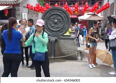 Tourists visit the yongxing food street in xi 'an, xi 'an, April 30, 2017. This is a famous food and intangible cultural heritage site in the west side of the city.