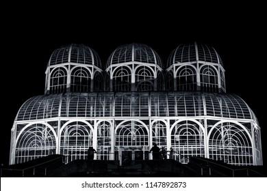 Tourists visiting the Botanical Garden of Curitiba at night.
