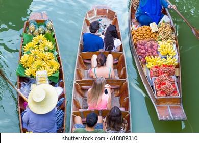 Tourists visiting by boat at Damnoen Saduak floating market in Ratchaburi near Bangkok, Thailand