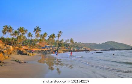 Tourists visiting the Ozran beach in Goa.