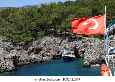 Tourists are visiting to phosphorous cave by sightseeing boats in Adrasan