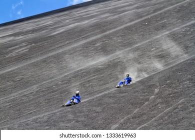Tourists are volcano boarding from Cerro Negro volcano, Nicaragua