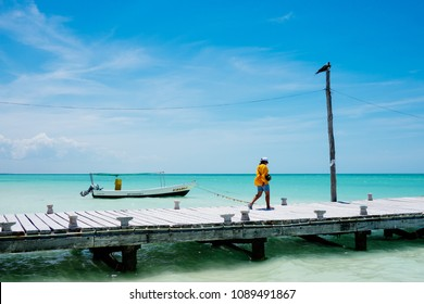 Tourists walk on the pier in Isla Holbox, Mexico on Wednesday, May 9, 2018.
