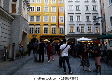 Tourists walk outside of Mozart's birthplace which was the birthplace of Wolfgang Amadeus Mozart at No. 9 Getreidegasse in Salzburg, Austria on Sep. 21, 2018