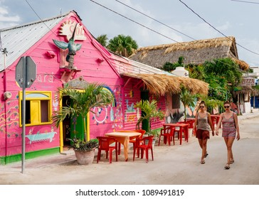 Tourists walk past a restaurant in the two of Isla Holbox, Mexico on Thursday, May 10, 2018.