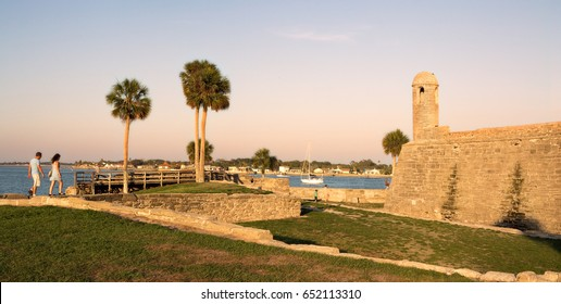 Tourists walk the walls of Castillo De San Marco, the oldest fort in the United States, in St Augustine Florida at sunset