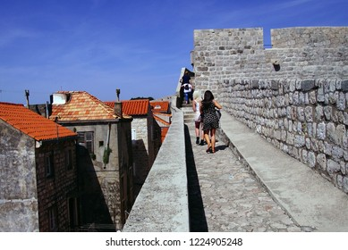 Tourists walking along the outer walls of Dubrovnik, Croatia