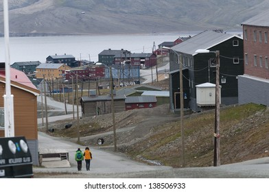 Tourists walking along a road in town, Longyearbyena, Svalbard, Norway