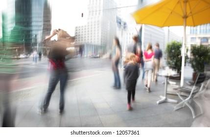 Tourists walking in berlin city. potsdamer platz