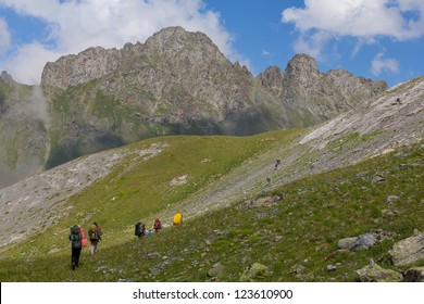 tourists walking by a mounta slope