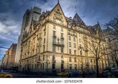 Tourists walking in front of the Dacota Building across the street from Central Park, January 23rd, 2018