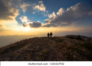 Tourists walking on a rocky top of a hill in Bieszczady Mountains, Poland