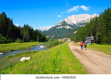 Tourists walking scenic path in Dolomite