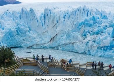 Tourists in walkways looking at Perito Moreno Glacier and Lago Argentino in El Calafate, Argentina