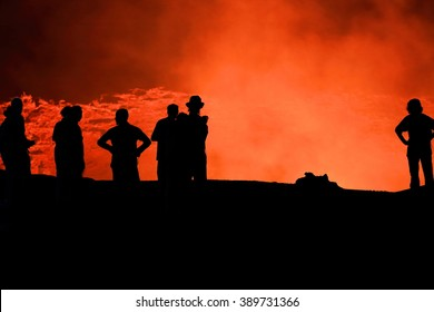 Tourists watching the world longest existing burning lava lake dating from 1906. Erta Ale basaltic shield volcano at 613 ms.high-eliptic crater of 0.7 x 1.6 km. Danakil desert-Afar region-Ethiopia
