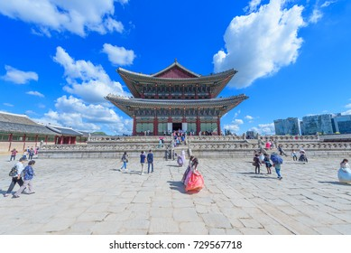Tourists wearing traditional Korean clothes Hanbok at the Gyeongbokgung Palace in Seoul City,South Korea.