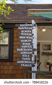 Touristy sign post with towns and cities in Europe and New England