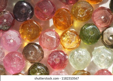 Tourmaline. Natural stone multi-colored tourmaline. Green, yellow, orange, pink, blue tourmaline. Colorful natural background.