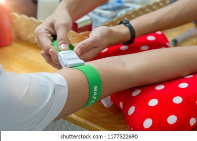 A tourniquet binding the arm tight preparing for blood drawn for laboratory examination